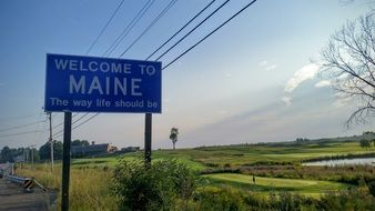 blue welcome to maine road sign
