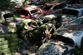 car cemetery in light and shadow