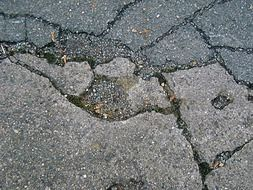 damaged asphalt road close-up