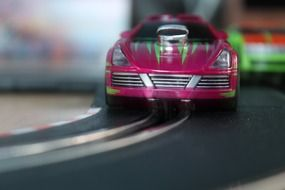 miniature pink toy car