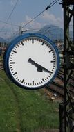 clock indicating the time at the railway station