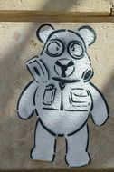 painted teddy bear on the wall
