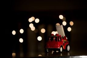 toy fire engine on christmas lights background