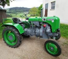 green tractor without roof