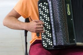 man playing an accordion