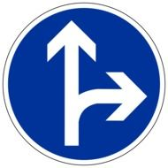 round blue road sign with arrows