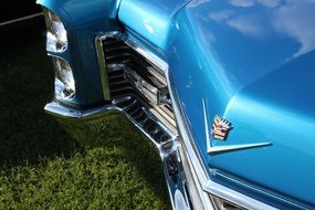 front view of a blue shiny classic auto close-up