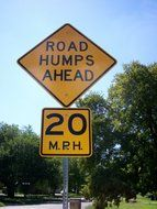 road humps ahead sign