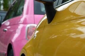 pink and yellow mini coopers closeup