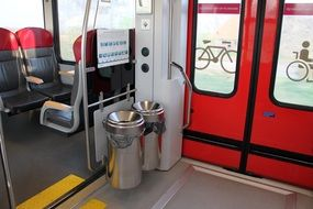 metal trashcans in train