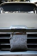 water bag on vintage car grill