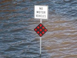 traffic sign in water during a flood
