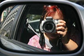 photo in the side mirror of a car