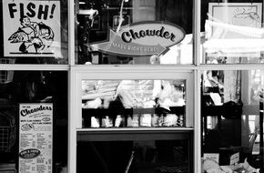 Black and white photo of urban fish chips shop