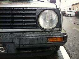 left headlight on a gray car