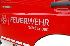 "The door of the fire truck with the inscription ""feuerwehr"""