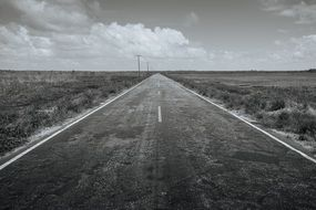 black-white highway under a cloudy sky