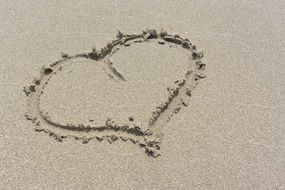 big heart on a sandy beach