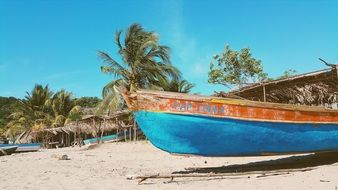 blue boat on a tropical beach
