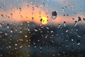 rain drops on window sunset