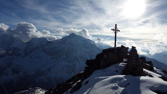 Cross on the mountain in the Alps