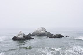 ocean sea water rocks fog cloudy
