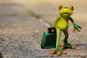 Statue of frog with luggage