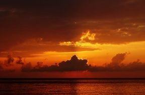 sunset ocean sea orange glow with clouds