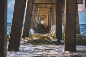ocean waves under the pier