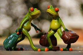 funny frogs with luggage