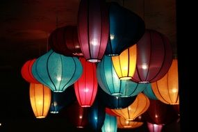 colorful decorative lanterns on dark celling