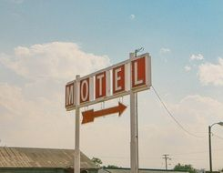 motel sign arrow travel holiday