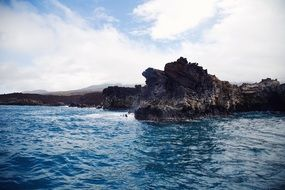 View from the water to the steep rocky coastline