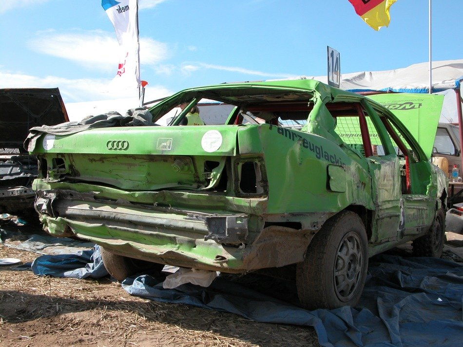 green car in a landfill