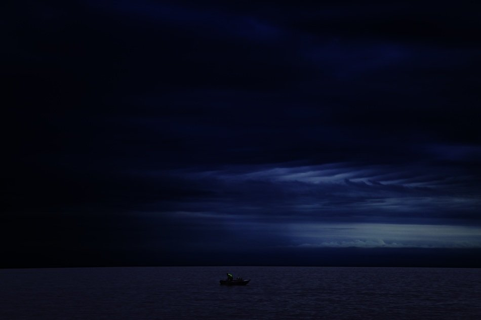 Boat in the ocean at night