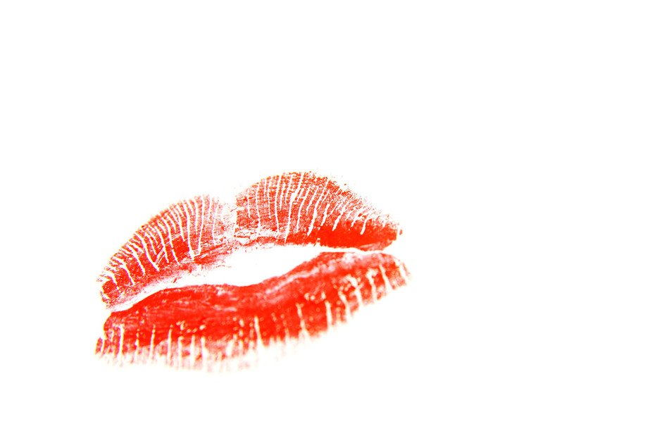red trace of lipstick on a white background
