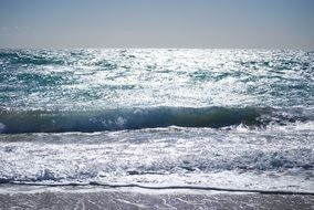 sea waves splashing on beach, spain, cadiz