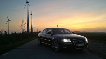 Audi on the road at dusk