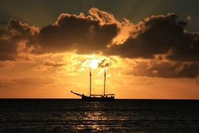 yacht in the sea on a background of bright sunset