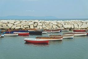 fishing boats moored at the stone fence