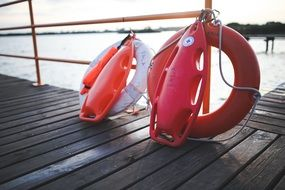 red life buoy on the beach