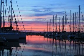 red sunset with sailing boats scenery