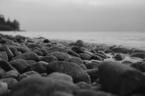 grey stones on beach sea panorama