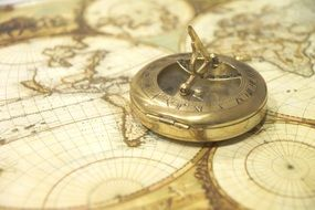 antique compass on world map
