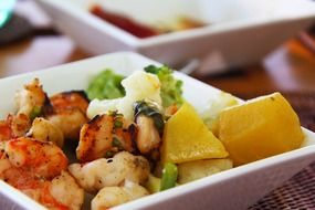 dish of prawns potatoes and vegetables