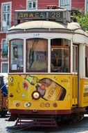 old yellow tram in lisbon portugal
