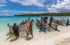 people with canoe on the beach in Papua New Guinea