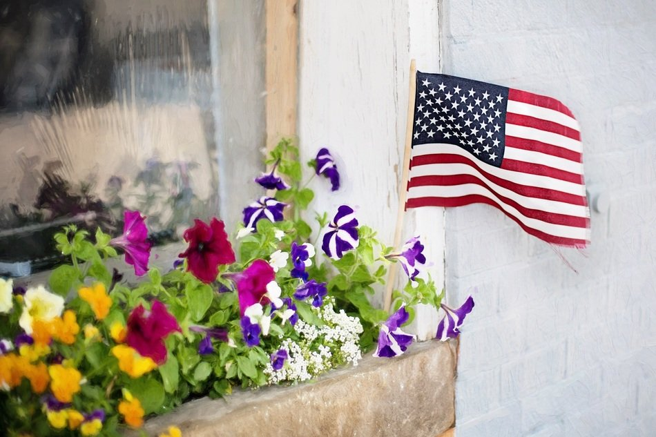 American flag in a flower bed