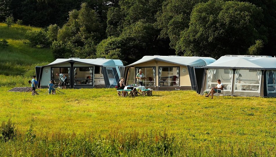 campground in a green meadow