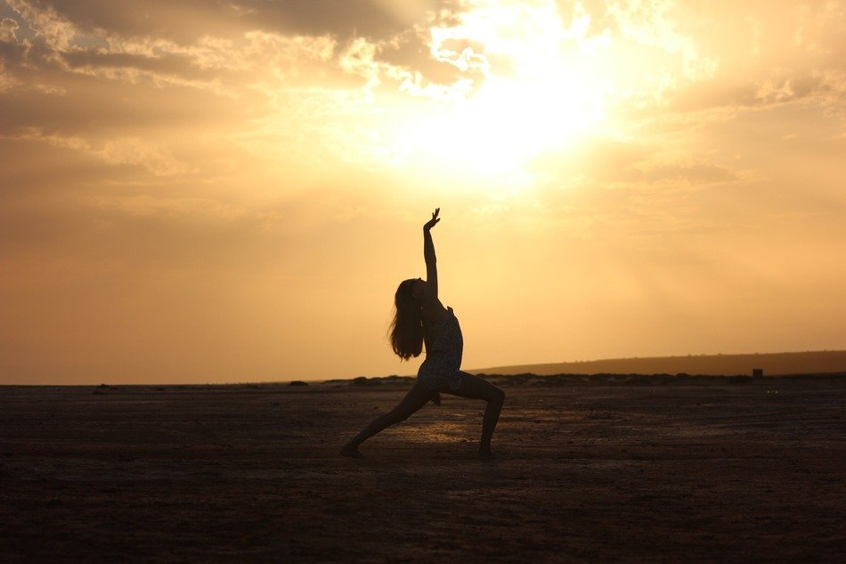 silhouette of a dancing girl on a sunset background